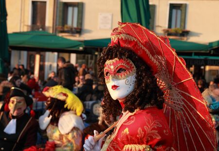 Venice,Italy,February 26th 2011:Portrait of a person wearing a characteristic masks on Sestiere Castello in Venice during the Carnival days.The Carnival of Venice (Carnevale di Venezia) is an annual festival, held in Venice, Italy and is now established a Stock Photo - 12257592