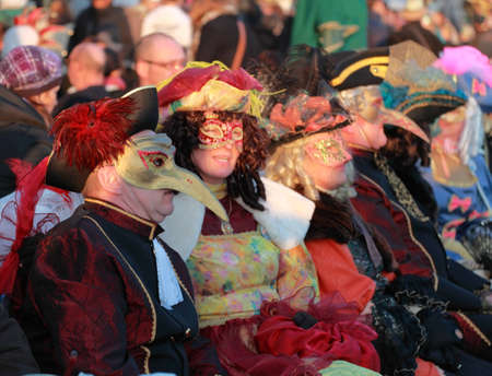 sestiere: Venice,Italy-February 26th, 2011: Image of a group of disugised people on a terrace on Sestiere Castello in Venice during the Carnival days.The Carnival of Venice (Carnevale di Venezia) is an annual festival, held in Venice, Italy and is now established a