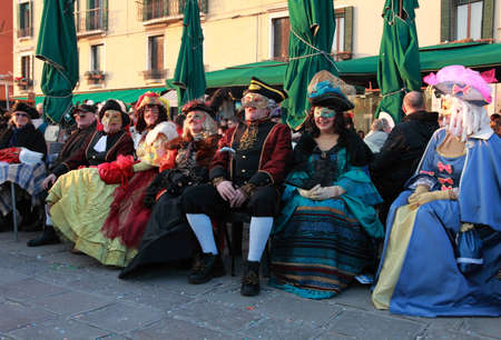 Venice,Italy-February 26th, 2011: Image of a group of disguised tourists having fun on a terrace on Sestiere Castello in Venice, during the Carnival days.The Carnival of Venice (Carnevale di Venezia) is an annual festival, held in Venice, Italy and is now