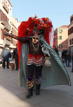sestiere: Venice,Italy-February 26th, 2011: Funny disguised woman walking in the street of Venice during the Carnival days.The Carnival of Venice (Carnevale di Venezia) is an annual festival, held in Venice, Italy and is now established as one of the worlds most c Editorial