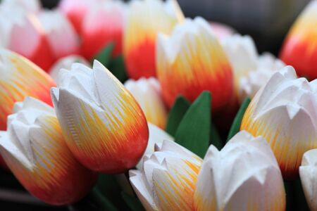 Image of colorful wooden tulips on a market stand in Amsterdam  photo