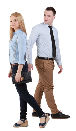 A man passing by a walking woman and casting a sly glance at her. Stock Photo - 13114173