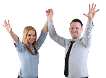 Young couple celebrating their success with hands raised isolated against a white background  photo
