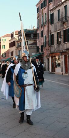 Venice,Italy,February 26th 2011: Young man disguised as a medieval standard bearer marching in a costumes parade on Sestiere Castello in Venice,during The Carnival days.The Carnival of Venice (Carnevale di Venezia) is an annual festival, held in Venice, I Stock Photo - 13182506