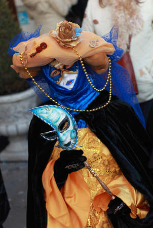 Venice,Italy-February 26th,2011: Image of a person wearing a complex venetian disguise during The Venice Carnival days.The Carnival of Venice (Carnevale di Venezia) is an annual festival, held in Venice, Italy and is now established as one of the world's  Stock Photo - 13182509