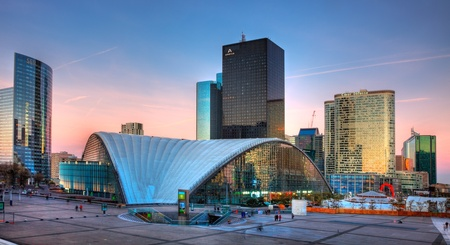Paris, France- April 1st, 2012: Image at the sunset of the famous business district, La Defense,in the western part of Paris.