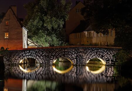 chartres: Image of the Pont du Massacre (Massacre Bridge) crossing the Eure river, during the yealry summer illumination nigths in Chartres in the Centre region of France.  Stock Photo