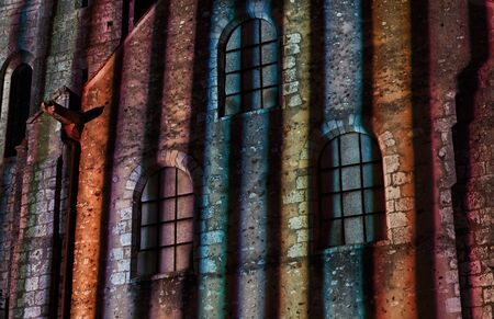 chartres: Detail of a wall of an old building in Chartres (Eure&Loir in France) during the yearly summer illumination nights. Stock Photo