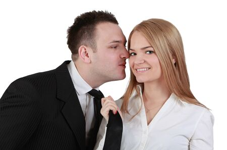 Image of a young couple fun while the woman pulls her boyfriend tie for a kiss. photo