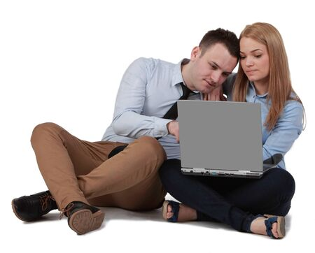 finding a mate: Young couple sitting together and working on a laptop  Stock Photo