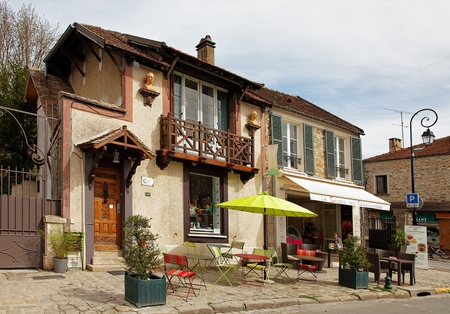 Barbizon,France- April 4th, 2011:Image of a traditional house and a street terrace in Barbizon, located in center of France near the Fontainebleu forest. During the second half of the XIXth century, here was an important school of painters The Barbizon s