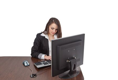 webdesigner: Image of a young brunette woman working on a computer at her desk, isolated against a white background.