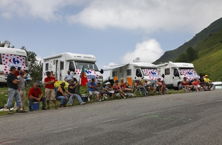 Gourette, France- July 15th, 2011: Image a group of tourists wainting for the cyclists on the road to Col Dabisuqe,in Pyrenees Mountains,  during the 13th stage of Le Tour de France 2011. The tourists came here in a caravan of camping cars.