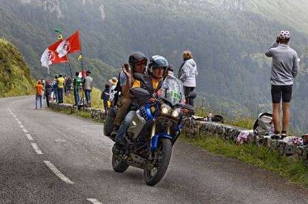Beost,France, July 15th 2011: Image of an official motorbike passing before the arrival of the peloton on the category H mountain pass Aubisque, during the 13th stage of Le Tour de France 2011.