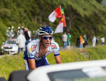 proffessional: Béost,France,July 15th 2011:Image of a cyclist climbing the category H mountain pass Aubisque,from Pyrenees mountains in the 13th stage of the 2011 edition of