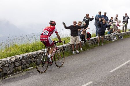 Beost, France, July 15th 2011: Image of the cyclsit David Moncutie (Cofidis team) climbing the category H mountain pass Aubisque, during the 13th stage of