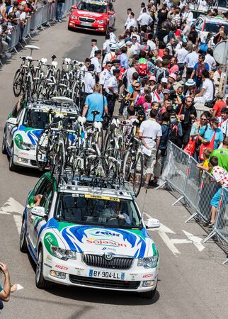 Rouen,France, July 5th 2012: Saur Sojansun Teams cars going to the passing by through a crowd of fans to reach the road of the race in Rouen, just before the start of the stage 5th of Le Tour de France 2012. The bikes of this team are Time RXRS Ulteam wi