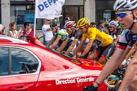 Rouen,France, July 5th 2012:The peloton at the real start point in Rouen (Stèle Jean Robic) during the stage 5th of Le Tour de France 2012.You can see there Fabian Cancellara, the leader of the race, wearing the Yellow Jersey.