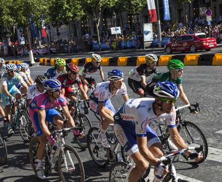 peloton: Paris,France, July 22nd 2012: The peloton riding during the final stage of Le Tour de France 2012 on Avenue des Champs Elysees in Paris.