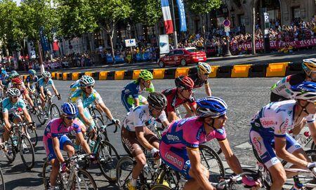 elysees: Paris,France, July 22nd 2012: The peloton riding during the final stage of Le Tour de France 2012 on Avenue des Champs Elysees in Paris.