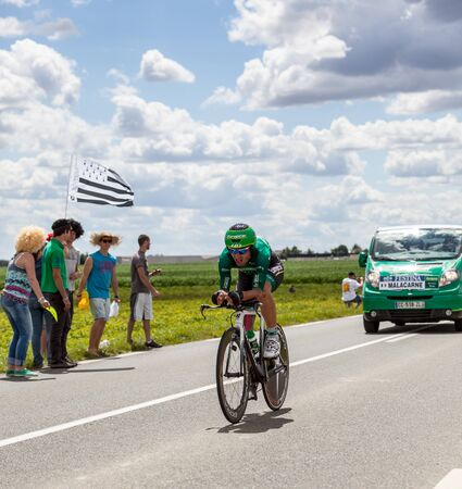 Beaurouvre,France,21st 2012:The Italian cyclist Malacarne Davide from Europcar Team passing by a group of spectators during the 19th stage of Le Tour de France 2012- a time trial  between Bonneval and Chartres.