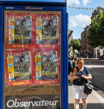 Rouen,France,July 5th, 2011: Image of a billboard full of cycling magazines containing information about the Tour of France, in  street of Rouen during the stage 5 of  Tour of France 2012