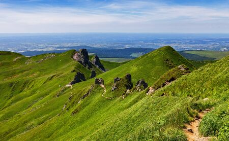 massif: Image of a hiking footpath in Puy de Sancy mountain located in The Central Massif in Central France.