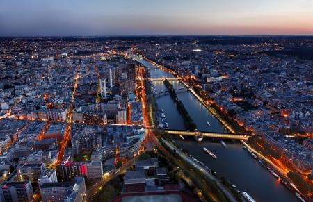Aerial image of the Seine river and beautiful illuminated quarters in Paris.