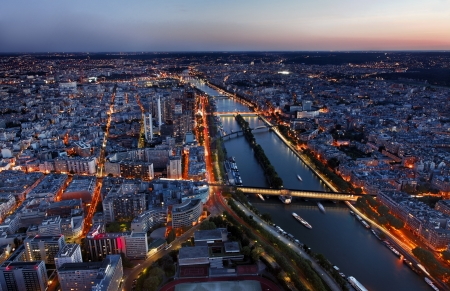 dawns: Aerial image of the Seine river and beautiful illuminated quarters in Paris.