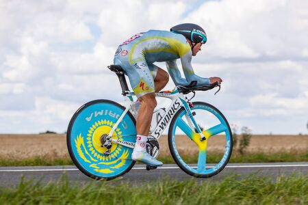 Beaurouvre,France,21st 2012:The Kazak cyclist Vinokourov Alexandr from Astana Pro Team pedaling during the 19th stage of Le Tour de France 2012- a time trial  between Bonneval and Chartres.One week later (28.07.2012) Vinokurov won the gold medal in  the O