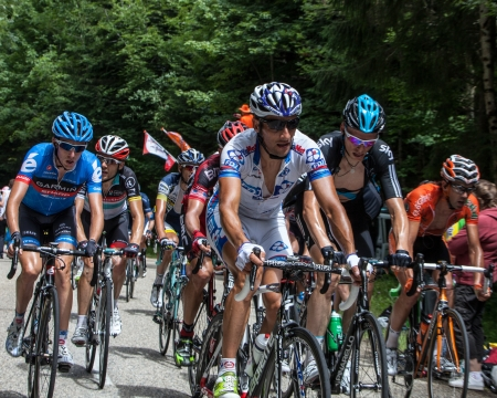 Entremonts,France-July 13th, 2012: Image of the peloton climbing the category mountain pass Granier in the 12 stage of the 2012 edition of Le Tour de France, the biggest cycling race in the world.