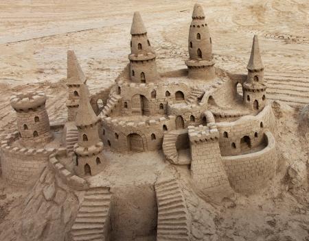 sandcastle: A beautiful sand castle on a beach.