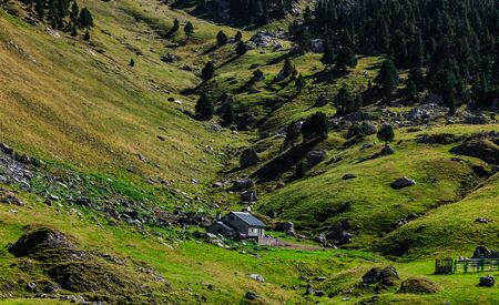 Image of a shelter located in a mountainous valley (Ossau Valley) in Pyrenees Mountains, France. Stock Photo - 15120027