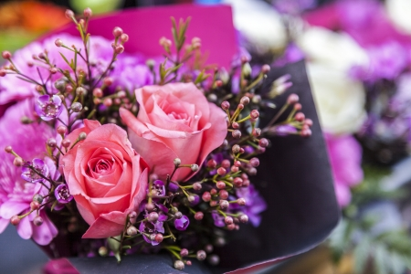 Close-up image of a beautiful flowers bouquet with two pink roses.
