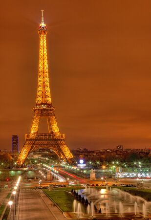 Paris, France- March 31st,2012: Image of the illuminated Eiffel Tower and its soroundings as it ca be seen from the hill of Trocadero.The tower stands 324 metres tall and is the most prominent symbol of both Paris and France.
