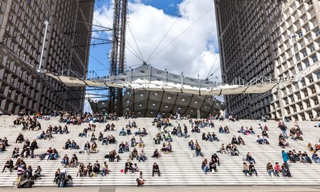 la defense: La Defense, France- April 19th, 2012: Image of various people having their frugal lunch on the steps under the Grand Arche in La Defense the main business district in western Paris.