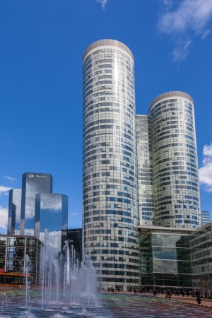la defense: La Defense, France- April 19th, 2012: Image of two central skyscrapers in La Defence, the main business district in western Paris. In the right is Coeur Defense and in the left is Totals Tower.