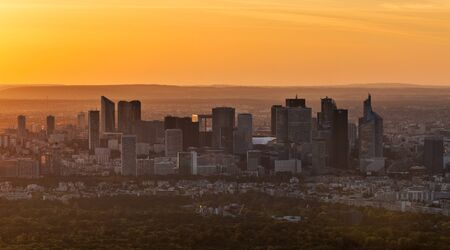 bird eye view: Paris,France- May 13th, 2012:Image at the sunset of La Defense, the famous business district from the westernmost part of Paris.