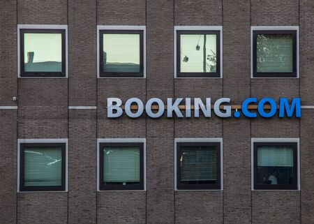 accomodation: Amsterdam,The Netherlands- October 31st, 2011: Image of the offices of Booking.com website located in Amsterdam. Booking.com is the leading worldwide online hotel reservations agency by room nights sold. Its based offices are located in Amsterdam.