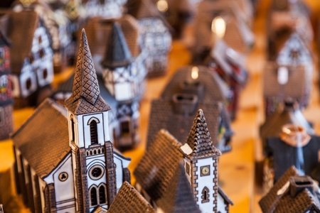 souvenir traditional: Specific Alsacian miniature ceramic houses on a sovenirs market stand in Alsace, France. Stock Photo