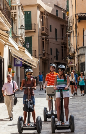 Palma de Mallorca, Spain- July 9, 2012: Tourists on segways visiting the streets of Palma de Mallorca the capital city in Balearic Island, Spain.