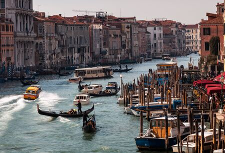 waterbus: Venice, Italy-February 18, 2012: Image of a fast ambulance motorboat speeding between various boats on The Grand Canal in Venice.