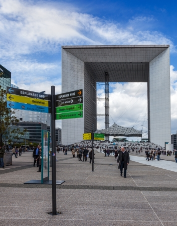 la defense: La Defense,France-April 19th, 2012: Businesspeople walking in front of Le Grand Arche in La Defence which is the main business district in western part of Paris, France.