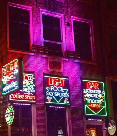 distric: Amsterdam,Netherlands- October 31st 2011: Night image of colorful coffee shop signs in the red district from Amsterdam. Editorial