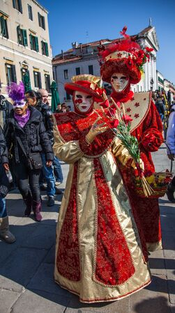 sestiere: Venice,Italy,February 26th 2011: Image of two actors wearing specific costumes and masks during the The Carnival of Venice days.The Carnival of Venice (Carnevale di Venezia) is one of the world biggest annual festival, held in Venice, Italy.During the Car
