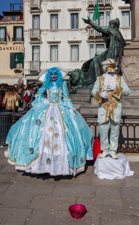 sestiere: Venice,Italy,February 26th 2011: A couple disguised in specific sophisticated Venetian costumes poses for tourists on Sestiere Castello during the Venice Carnival days. Editorial