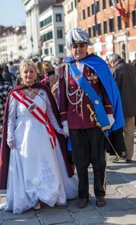 sestiere: Venice, Italy- February 26th, 2011: A mature couple disguised in medieval Austrian military clothes on Sestiere Castello in Venice during the Carnival days.