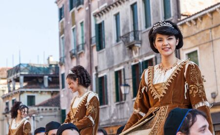 sestiere: Venice, Italy- February 26th, 2011: Image of pretty young medieval ladies during a parade of traditional costumes in Venice, during The Carnival days.