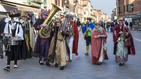 Venice,Italy-Ferburary 26th, 2011: Funny orchestra marching and singing in the streets of Venice during The Carnival days. Stock Photo - 16585678