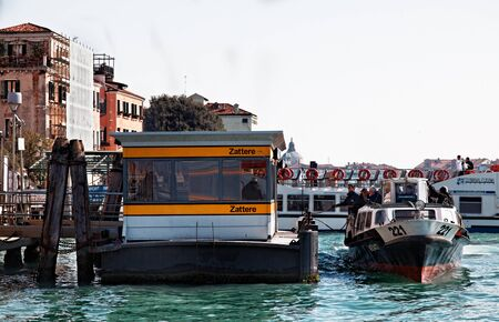 ply: Venice, Italy- February 26th, 2011: Image of a Vaporetto reaching the Zattere Station on The Grand Canal in Venice during the Carnival days. Vaporeto is a motorised waterbus which ply regular routes along the major canals and between the citys islands. Editorial